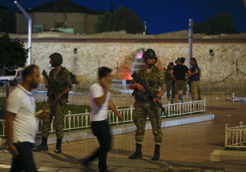 Turkish military stand guard in the Taksim Square in Istanbul