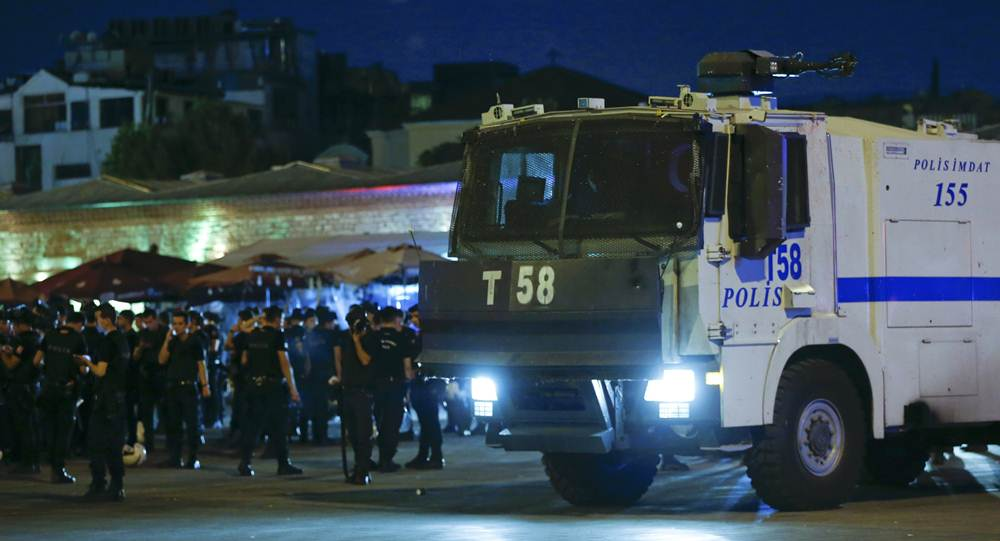 Turkish police officers stand by a car near the Taksim Square in Istanbul