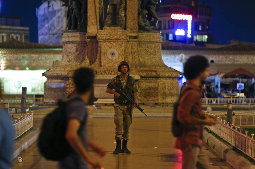 A Turkish military stands guard in the Taksim Square in Istanbul