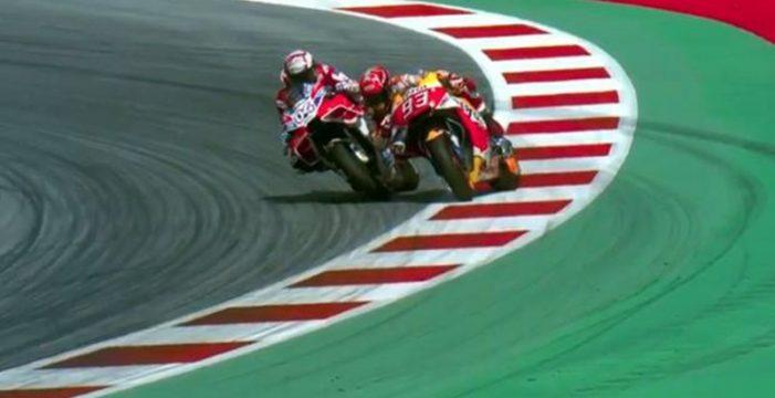 Dovizioso se lleva la batalla con Márquez en MotoGP y Pedrosa completa el podio